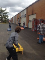 Pictured above are our FFA members going head to head in a game of corn hole during the activities of the week.