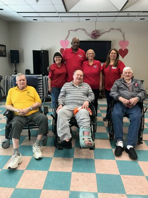 Pictured at a Valentine's party, from left in the front row, are Richard M. Campbell Veterans Nursing Home residents residents Val Kirk, Benjamin Dearybury and Palmy Cleveland. In the back row, from left, are Margaret Miller, Johnny Davis and Jody Patterson of Pendleton Elks Lodge No. 2861 and Sherry Fleming, activities director at the nursing home.