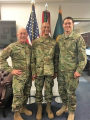 Photo taken following Francisco Espaillat's promotion to Major General on March 27.  From the left is his boss, 3-Star General Luckey, Maj. Gen. Espaillat, and his son, Captain Richard Espaillat.