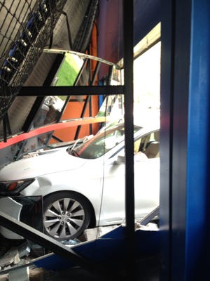 A motor vehicle crashed through the wall of Sky Zone Trampoline Park on Tuesday afternoon.