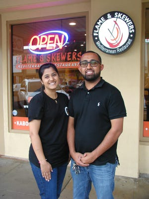 Mitesh and Pinkal Mistry are the new owners of downtown Visalia's Flame and Skewers Mediterranean Restaurant.