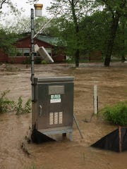 Floodwaters move past a USGS stream gauge near the Current River at Montauk State Park in this photo posted to the USGS Missouri Facebook account on Sunday. This gauge is one of many in the state paid for in part by the Missouri Department of Natural Resources and threatened for closure in July if more funding is not found.