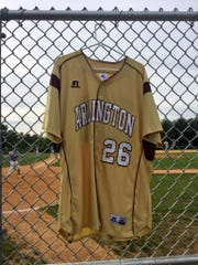 The Arlington baseball team hangs in its dugout the jersey of former teammate Evin Kleinganz, 20, whose body was recovered from the Hudson River on May 20, 2017. Kleinganz's canoe capsized, according to the Dutchess County Sheriff's Office.