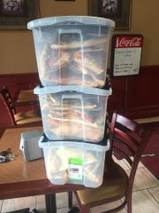 Leftover food is packed up so it can be redistributed