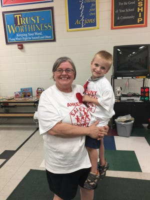 Ankeny Safety Town Director Cindy Arbogast with her grandson, Solomon Bored. Arbogast is stepping down as the director after volunteering for the program for 26 years.