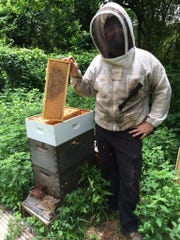 Drew Ruegg, co-owner of Honey Badger Bee Rescue and