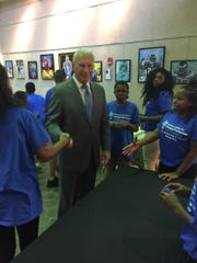 Wilmington Mayor Mike Purzycki greets Junior Entrepreneurs in Training Friday.