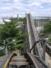 """A vertiginous point-of-view shot at the top of a """"drop"""" of the Zippin Pippin, when it was at Libertyland. (That's the Liberty Bowl in the background.)"""