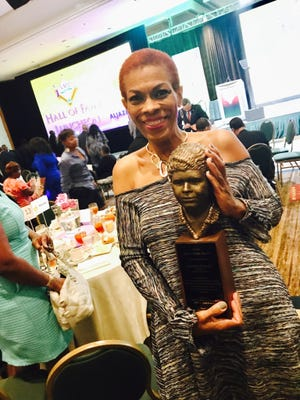 Rochelle Riley holds the coveted Ida B. Wells bust, named for the journalist, civil right activist and anti-lynching crusader whose iconic career empowered others. Riley received the award at the annual convention of the National Association of Black Journalists for excellence in journalism and mentoring hundreds of young journalists.