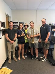 Members of the Harmony Club of Abilene donate refurbished