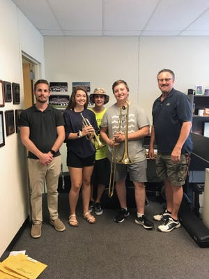 Members of the Harmony Club of Abilene donate refurbished instruments to the Clyde High School band. From left: assistant band director Ryan McCully, Elizabeth Dugan, Josh Browning, Jordan Browning and band director Bruce Morgan.