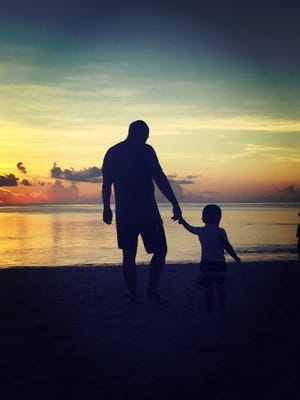 Johnny and Ilias Su share a father and son moment behind Outrigger.