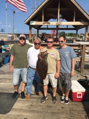 Brian Donahue (left), Kenny Zaniewski, Mike Donahue and Anthony Shifini with a doormat fluke caught on the Miss Eileen on Aug. 20, 2017 during the Wagner's Marina Tournament. The fish won first place.