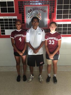Team captains for Bloomfield High girls soccer, Anatalia Pena (left) and Grace Perrotta, along with coach Jon Aliaga.