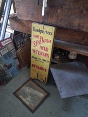 A board advertising the headquarters of the United Spanish War Veterans sits in the Coliseum.