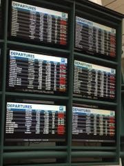 The Orlando International Airport flight board shows