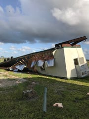 An empty portable being stored at a bus depot in Buckingham was flipped over and crushed by the wind of Hurricane Irma.