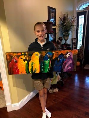 Ella Gough with her prize winning artwork.