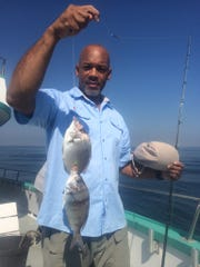 Rodney Smiling of East Orange with a two porgies on