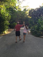 Robert Ramstorf, 74, left, and his granddaughter Emma, 11, walk through the Naples Zoo. Ramstorf died Sept. 16 from injuries suffered during Hurricane Irma.