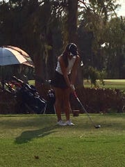 Estero junior Kim Egozi lines up a shot during a match