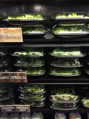 The salad station at the District Market lets diners pick their greens and then add toppings and dressings.