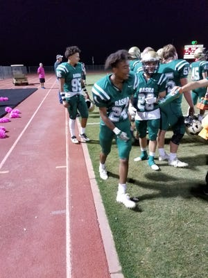 Basha football players celebrate during their win over Brophy Prep.