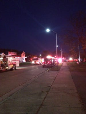 Fire trucks start out in the Silent Remembrance Parade in downtown Colby on Wednesday night to honor fallen firefighters.