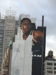 An image of Knicks rookie Frank Ntilikina is going up in Manhattan on Friday, Oct. 13, 2017.