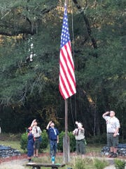 Scouts participate in morning flag ceremony to show patriotism and learn duty to country at cub family weekend at Wallwood Boy Scout Reservation in Quincy.
