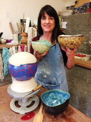 Ellen Bothanks shows some of the works that will be available at the 2nd annual Bowl of Thanks fundraiser from 11 a.m. to 4 p.m. Nov. 5 at Ventura Harbor Village.