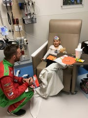 Pro race-car driver Ross Chastain of Alva visited patients