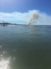 A fire on Little St. George Island is believed to have been started by two teens from Kentucky.