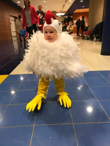 Violet Graceann dressed up as a chicken for Halloween.