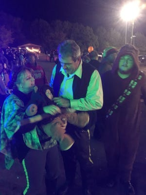 Nichole Ramsey, baby Conner Ramsey, Clifton Ramsey and Colin Smith dressed as Han and Leia in their Battle of Endor outfits with a baby Ewok and Chewbacca.