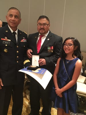 After the gala for the Congressional Gold Medal presentation last month, Edel Alayon and his daughter Katherine met Maj. Gen. Eldon Regua. Regua spoke during the dinner, telling stories of three heroes from the war.