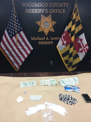 The items seized from the vehicle of Monica Snee, 51 of Salisbury, include suspected heroin, Oxycodone, Suboxone strips and cash. Photo courtesy of Wicomico Sheriff's Office.