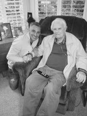 William Graham Tullian Tchavidjian kneels by his famous grandfather Billy Graham.