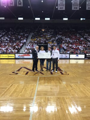 Kyocera and Kevin and Becky Horner of PTS Office Systems, Inc. teamed up and contributed $50,000 to the Aggie Athletics Club.