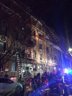 A handout photo made available by the Fire Department of the City of New York shows firefighters operating at the scene of a four-alarm fire at an apartment building in the Bronx borough of New York, on Dec. 28, 2017.