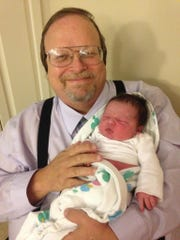 Robert Westerman holding one of his grandchildren.