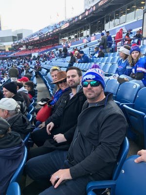 Cincinnati Reds outfielder Jesse Winker (second from right) attends the Dec. 3 Buffalo Bills game with his family, father Joe, mother Karen and brother Joey.