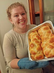 Phoebe Skowronski shows off the two breads she made at the Mega Challah Bake at the Jewish Community Center.