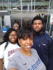 Memphis F Mike Parks, Jr. (right), with his mother Jamie Gambrell (center) and two younger sisters.