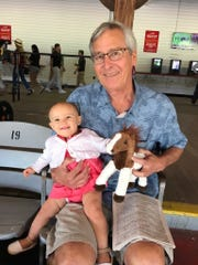 Tom Wojdyla with his granddaughter: successful treatment means he can still enjoy life.