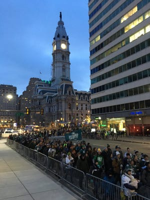 Eagles fans gather near City Hall in Philadelphia at 5:30 a.m. for the Super Bowl parade.