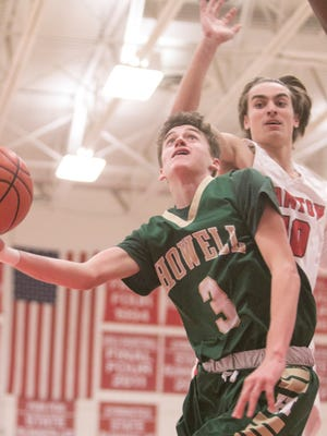 Howell's Kip French drives to the basket against Canton on Tuesday, Feb. 20, 2018.