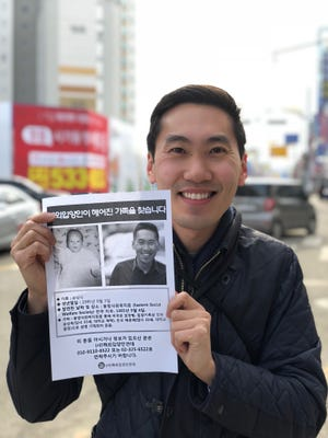 While in Korea for the Olympics, Ted Arthur, a Harrison High School graduate, put up fliers looking for clues about his birth parents in the town where he was born and later adopted.