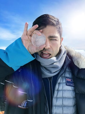U.S. actor and environmentalist Adrian Grenier checks out an ice-core sample as part of a new Antarctica-focused safety video for Air New Zealand.