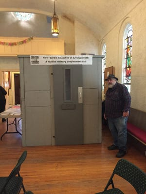 The Campaign for Alternatives to Isolated Confinement is displaying a replica solitary confinement cell at South Wedge Mission.